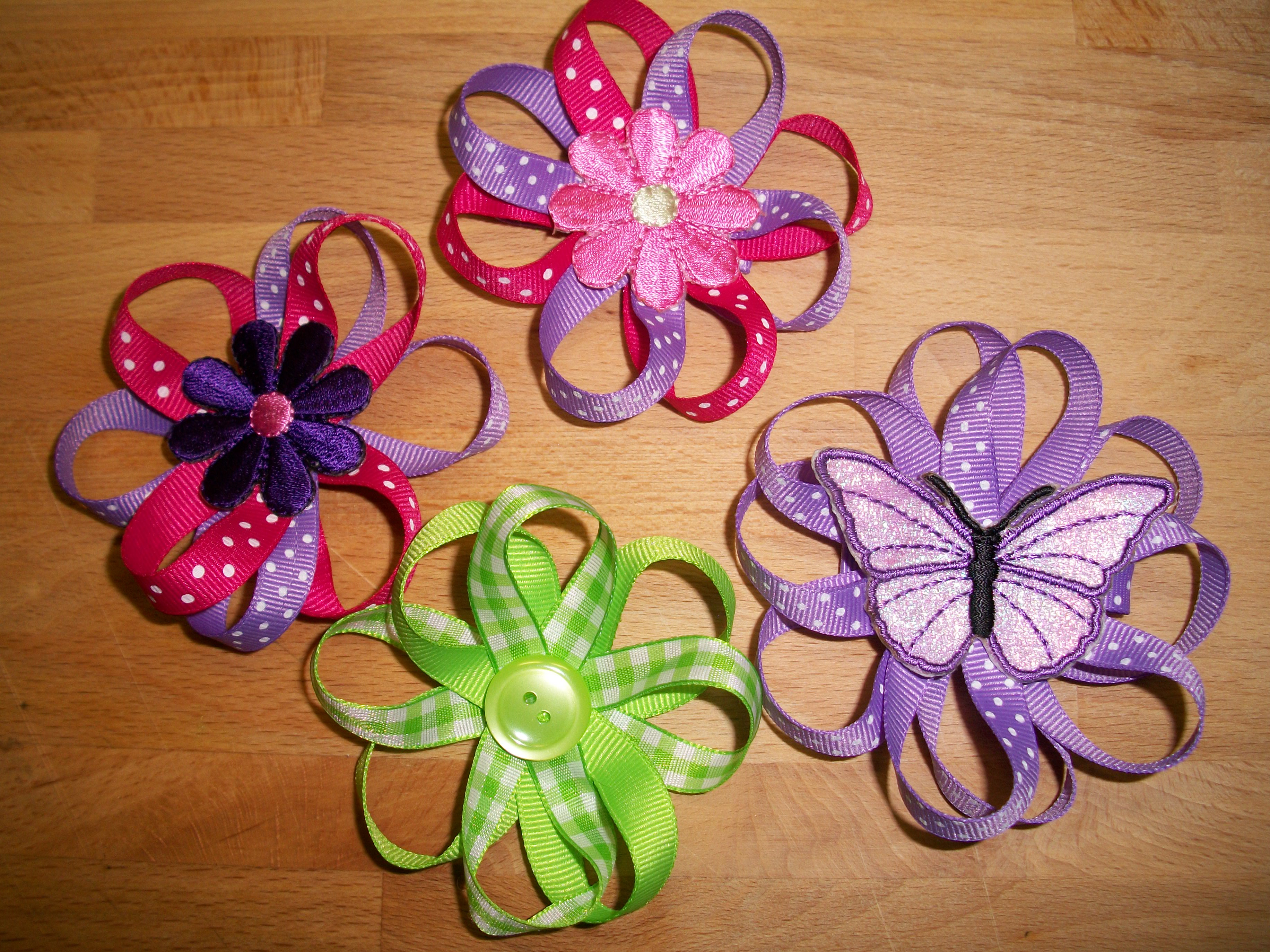 Fabric flowers with bling! Or any kinda fabric flowers Find this Pin and more on DIY HAIR BOWS/FLOWERS by Tessie Diver. DIY Fabric Flowers diy instructions directions project do it yourself step by step stepbystep how to howto pictorial tutorial good for head bands.